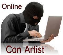 Man in black ski mask on computer