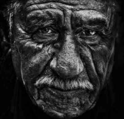 B&W Image Of An Old Man With A Worried Look For Top Senior Citizen Scams