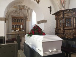 Top senior citizen scams-funeral scams- Casket in church