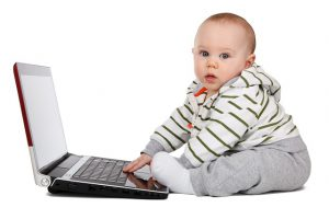 Baby on Computer - Credit Repair Magic