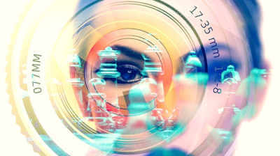 Woman Looking Through A Superimposed Camera Lens Outline For How to Optimize Images On Your Website